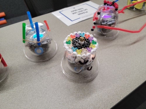 3 Bolt robots in decorated cups.